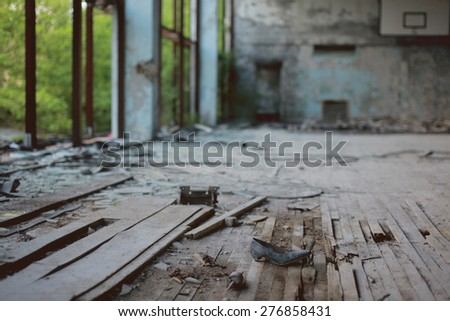 PRIPYAT, UKRAINE - MAY 9, 2015 - Female shoe in abandoned gymnasium in Pripyat - stock photo