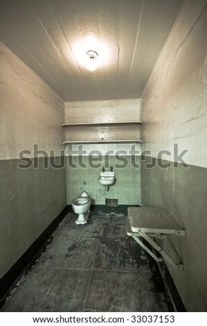 Prison cell at the historic Alcatraz island. Photo processed for impact. - stock photo