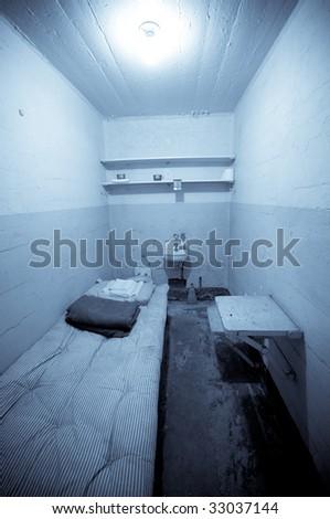 Prison cell at the historic Alcatraz island. Photo processed in selenium tone for impact. - stock photo