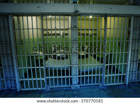 Prison cell behind the bars in America - stock photo