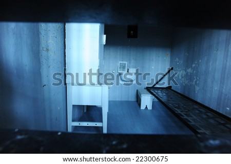 prison cell in blue light - stock photo