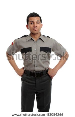 Prison guard, warden, or cop standing firm with hands on hip - stock photo