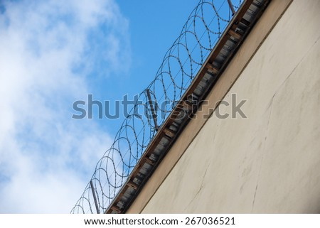 Prison wall with barbed wire in Poland - stock photo