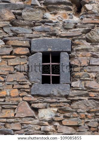 Prison window in castle wall (dark age) - stock photo
