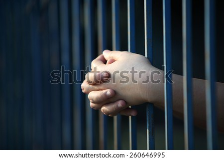 prisoner hand in jail - stock photo