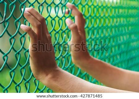 prisoner hand in jail. freedom concept - stock photo