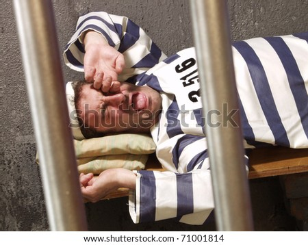 Prisoner in a prison cell. - stock photo