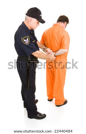 Prisoner in orange jumpsuit is being handcuffed by police officer.  Full body isolated on white. - stock photo
