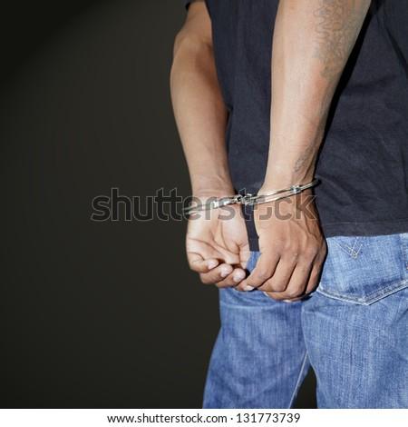 Prisoner locked in handcuffs - stock photo