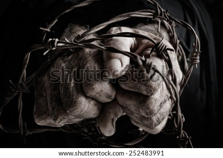 Prisoner of war in barbed wire - stock photo