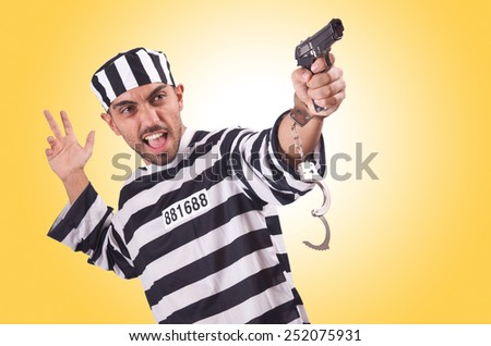 Prisoner with gun isolated on white - stock photo