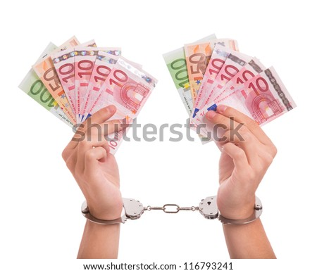 Prisoner with handcuffs and money in his hands - stock photo