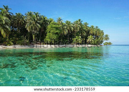 Pristine Caribbean island with lush vegetation in the marine park of Bastimentos, Cayos Zapatilla, Bocas del Toro, Panama - stock photo