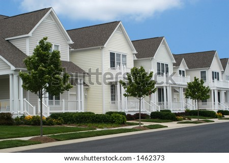 Pristine Houses in a Row - stock photo