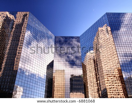 Pristine image of city buildings against a perfect blue sky. If you look closely you can also see the moon - stock photo