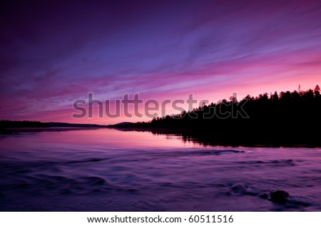 Pristine nature of the Russian North, beautiful sunset over the lake. North Karelia - stock photo
