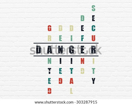 Privacy concept: Painted black word Danger in solving Crossword Puzzle, 3d render