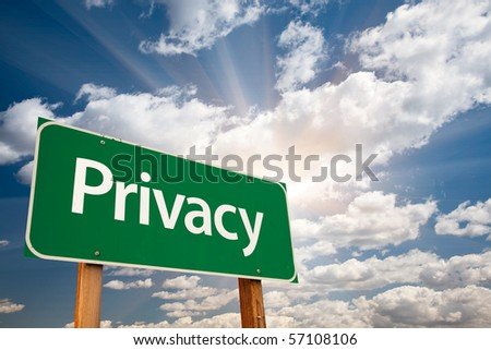 Privacy Green Road Sign with Dramatic Clouds, Sun Rays and Sky. - stock photo