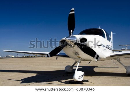 Private Airplane A private single engine propeller airplane. Horizontal. - stock photo
