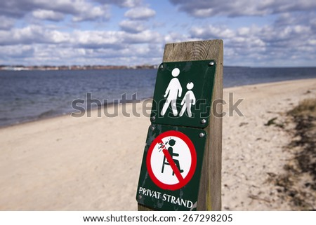 Private beach sign on Danish coastline. - stock photo