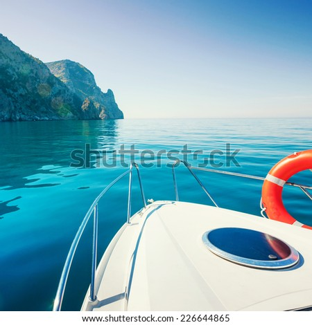 Private boat floats near the mountains. Luxury Lifestyle. Traveling on a yacht.
