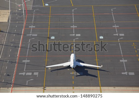 Private business jet is waiting at the airport - stock photo