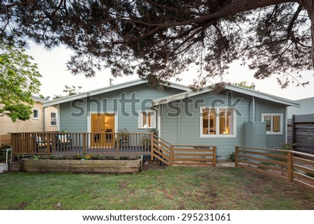 Private craftsman home with green yard at twilight.  - stock photo