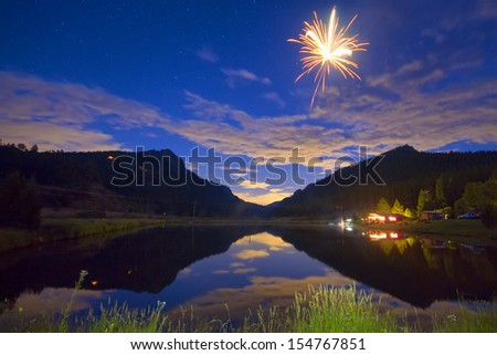 Private Fireworks show high up in the Colorado Rocky Mountains looking out into the plains.    - stock photo