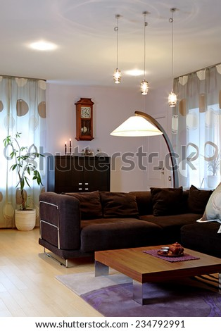Private house interior. Guest room, desk, floor lamp. Vertical.