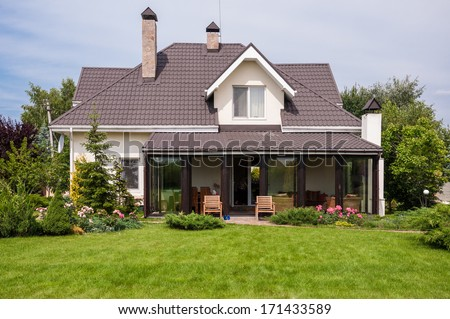 private house with garden - stock photo