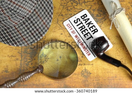 Private Investigation Concept. Sherlock Holmes Deerstalker Cap,  Sign BAKER STREET, Roll Of Paper And Vintage Magnifier On The Old Map Background. Top View. - stock photo