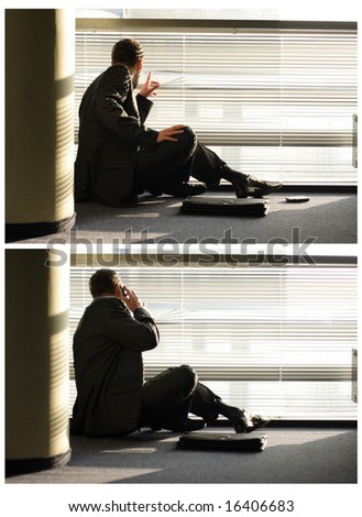 Private investigator looking through window blinds and calling on phone - stock photo