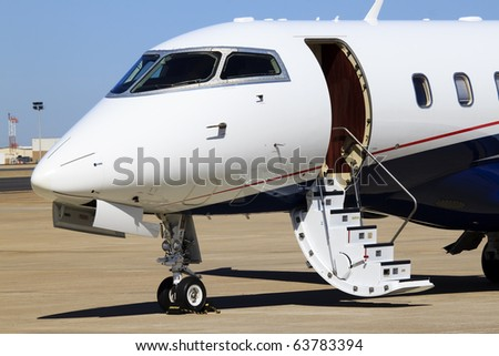 Private Jet A private jet airplane waits for passengers. Horizontal. - stock photo