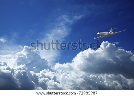 Private jet aircraft in a blue sky - stock photo