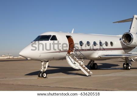 Private Jet Airplane A private jet airplane waiting for passengers. Horizontal. - stock photo