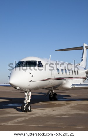 Private Jet Airplane Front view of a private jet airplane. Vertical. - stock photo