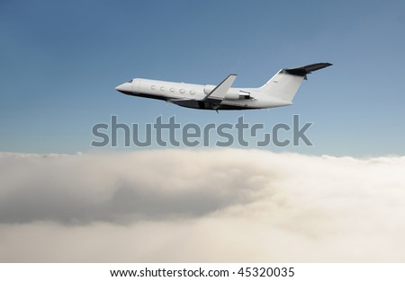 Private jet airplane soaring over the clouds - stock photo