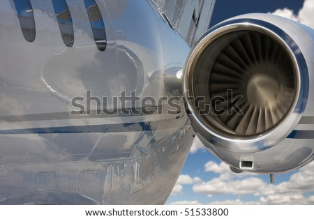 Private Jet and Engine Abstract Over Clouds and Sky. - stock photo