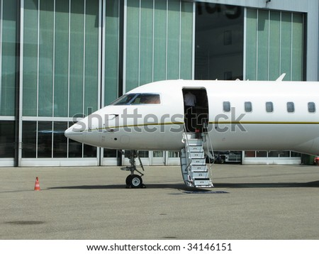 Private jet at shed - stock photo