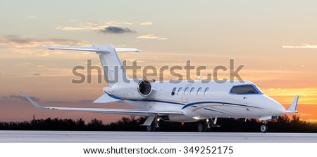 Private jet at the airport ready for take off - stock photo