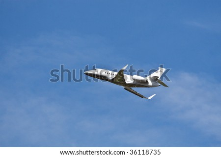 Private jet in the blue sky - stock photo