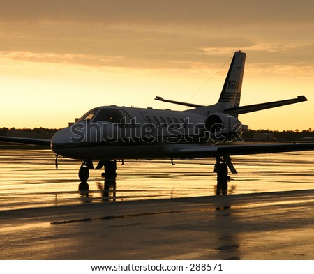 Private Jet on Stormy Ramp - stock photo