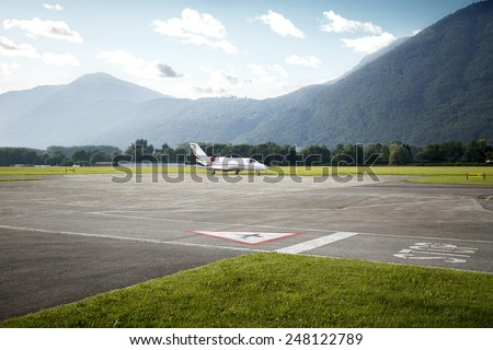 Private jet parked on the airport - stock photo