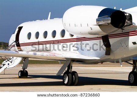 Private jet parked on the tarmac - stock photo