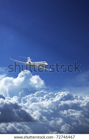 Private jet plane in a blue sky - stock photo