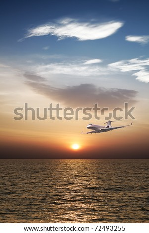 Private jet plane in flight - stock photo
