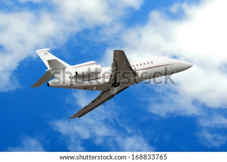 Private jet plane in the blue sky