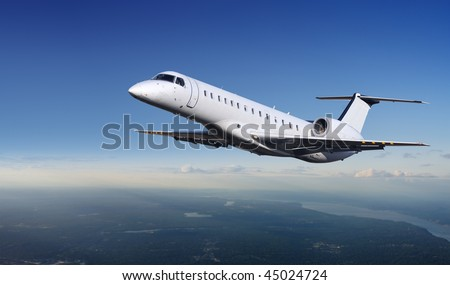 Private Jet plane in the sky - stock photo