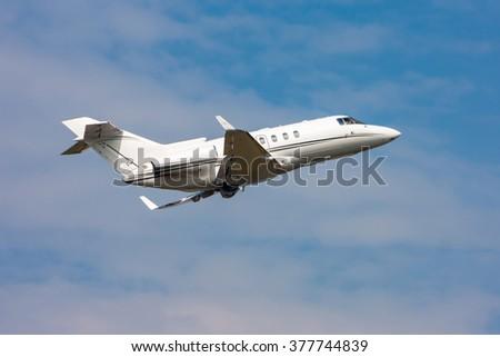 Private jet plane taking off - stock photo