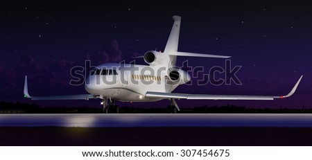 Private jet taxiing in the dark - stock photo